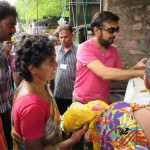 Actor Mohan Distributes foods To Flood Victims